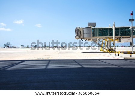 Jetway waiting in airport - stock photo