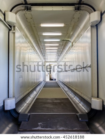 Jetway, walking towards the plane, seeing the door of the plane, selective focus