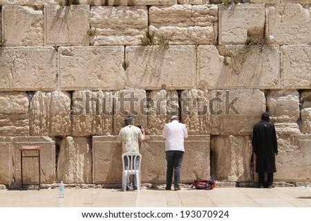jew at the wailing wall jerusalem prayer - stock photo