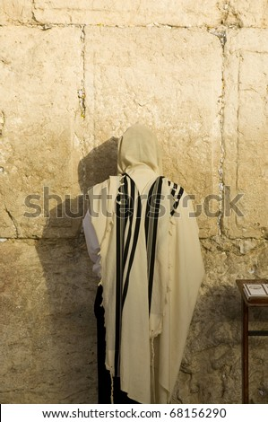 Jew is praying at the western wall - stock photo