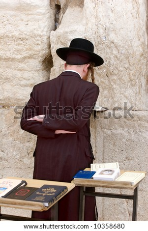 Jew prays in the wailing wall in Jerusalem. - stock photo
