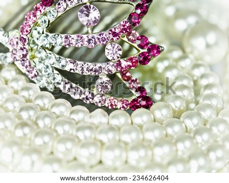 Jewel crest and jewelery with pearl beads - stock photo