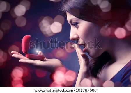 Jewel in the open case and admired woman. - stock photo