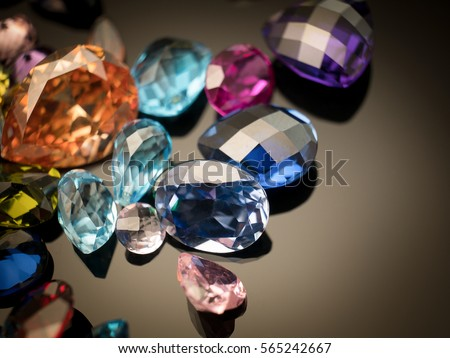 Jewel or gems on black shine color, Collection of many different natural gemstones amethyst, lapis lazuli, rose quartz, citrine, ruby, amazonite, moonstone, labradorite, chalcedony, blue topaz