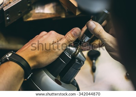 Jeweler working on a ring with precision tools