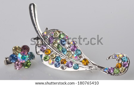 jewellery. brooches on the background - stock photo