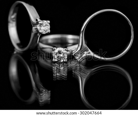 Jewellery diamond ring on a black background. - stock photo