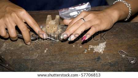 jewellery making in workshop in Bali - stock photo
