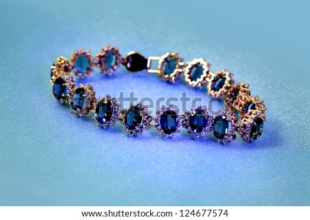 Jewelry accessories - bracelet with sapphire and brilliants in blue light - stock photo