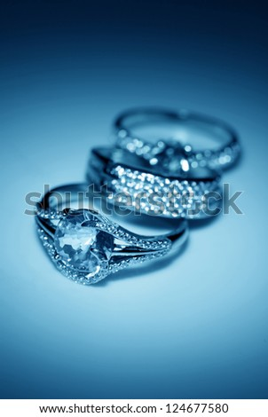 Jewelry accessories - golden rings in blue light in blue light