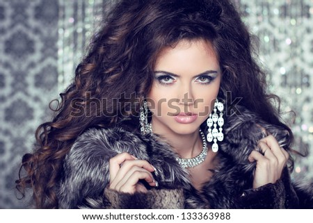 Jewelry and Fashion lady. Beautiful Woman wearing in Luxury Fur Coat over - stock photo