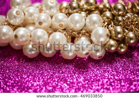 Jewelry background with white and golden pearls