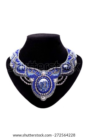 Jewelry. Beaded necklace with blue stones - stock photo
