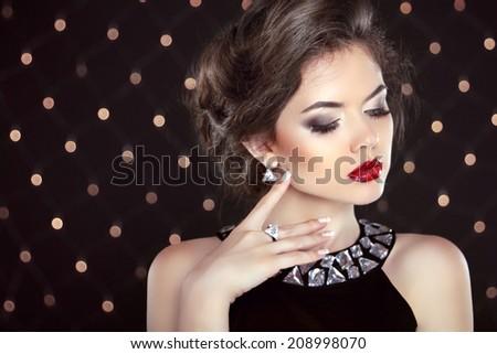 Jewelry. Beautiful brunette young woman. Fashion girl model over bokeh lights background - stock photo