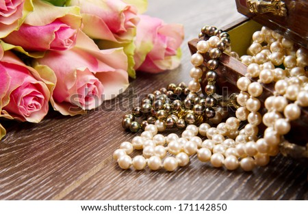 jewelry box with jewelry  with pink roses - stock photo