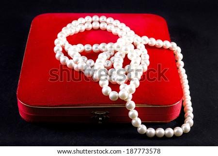 Jewelry box with necklace of precious stones  - stock photo