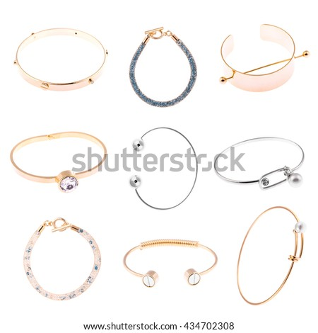jewelry collection of gold and silver bracelets isolated on white