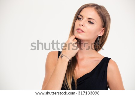 Jewelry concept. Portrait of a lovely female model standing isolated on a white background - stock photo