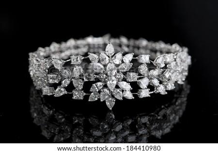 Jewelry diamond bracelet on a black background - stock photo