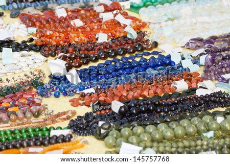 Jewelry from natural gems at store - stock photo