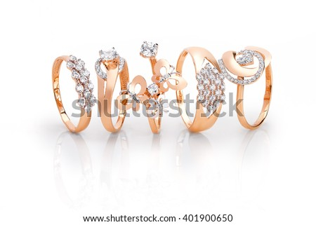 Jewelry gold set of ring with diamonds on white background - stock photo