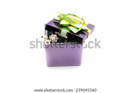Jewelry in gift box with bow. Isolated object on white background.