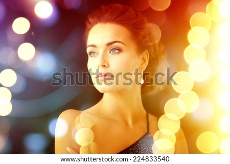 jewelry, luxury, vip, nightlife, party concept - beautiful woman in evening dress wearing diamond earrings - stock photo
