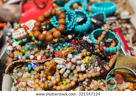 Jewelry necklaces and vintage bracelets for sale at flea market - stock photo