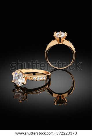 jewelry ring with diamonds on black background with reflection - stock photo