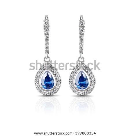 Jewelry. Silver earrings with sapphires - stock photo