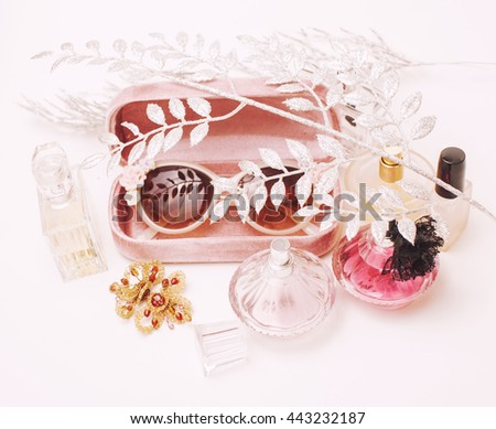 Jewelry table with lot of girl stuff on it, little mess in cosmetic brushes, women interior concept, perfume elegance things