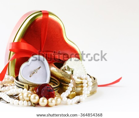 jewels and pearls for gift with boxes heart  - stock photo