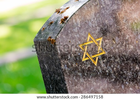 Jewish cemetery: Star of David on the tombstone - stock photo