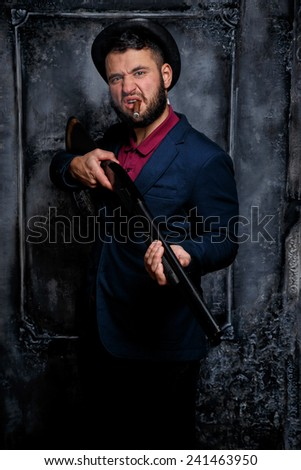 Jewish gansgter smoking a cig.Against art-wall on the background - stock photo