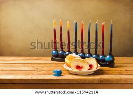 Jewish Hanukkah symbols on wooden table - stock photo