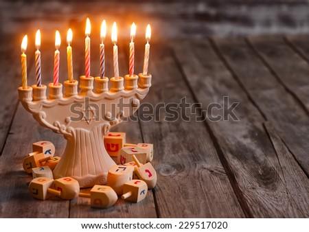 Jewish holiday hannukah symbols - menorah and wooden dreidels. C - stock photo