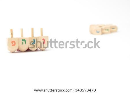 Jewish holiday hanukkah celebration - Dreidels on a white background isolated - stock photo
