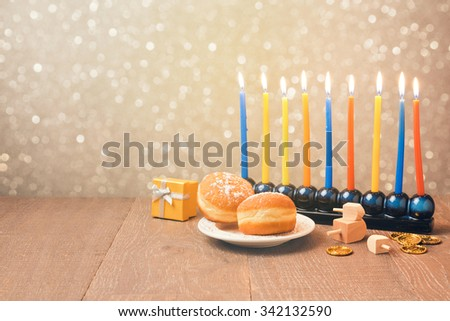 Jewish holiday Hanukkah celebration with menorah over bokeh background. Retro filter effect - stock photo