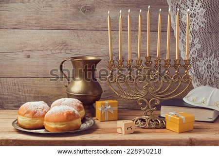 Jewish holiday hanukkah celebration with vintage menorah - stock photo