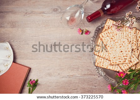 Jewish holiday Passover background with matzah, seder plate and wine. View from above - stock photo