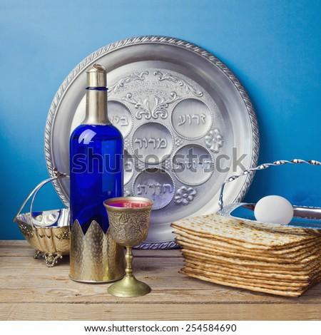 Jewish holiday Passover celebration with matzo and wine  - stock photo
