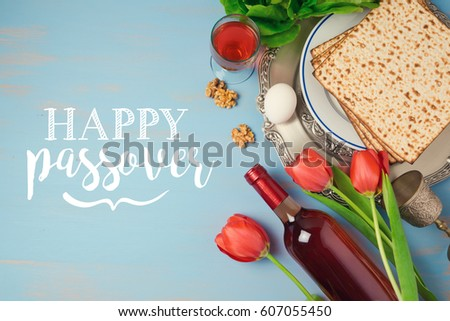 Jewish holiday passover pesah greeting card stock photo royalty jewish holiday passover pesah greeting card with seder plate matzoh and flowers over blue background m4hsunfo
