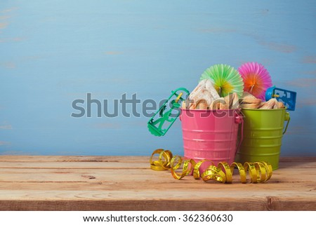 Jewish holiday Purim carnival background with traditional gifts on wooden table - stock photo