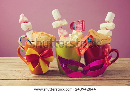 Jewish holiday Purim traditional gifts with hamantaschen cookies and candy - stock photo