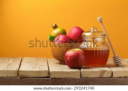 Jewish holiday Rosh Hashana (new year) celebration with honey jar and apples - stock photo