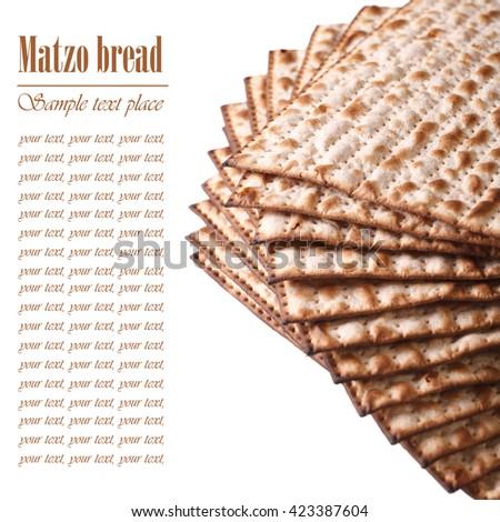 Jewish kosher matzo for Passover macro isolated on white background. text - stock photo