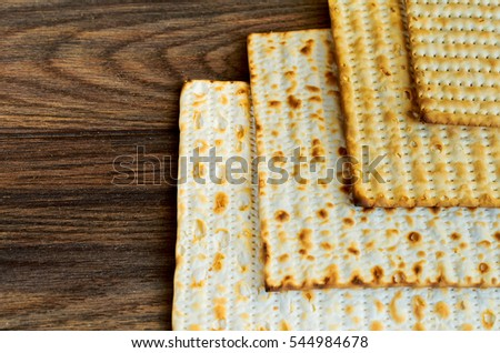 jewish products food, Jewish Holiday symbol Matzoh for jewish holiday Passover pesah on wooden background. View from above