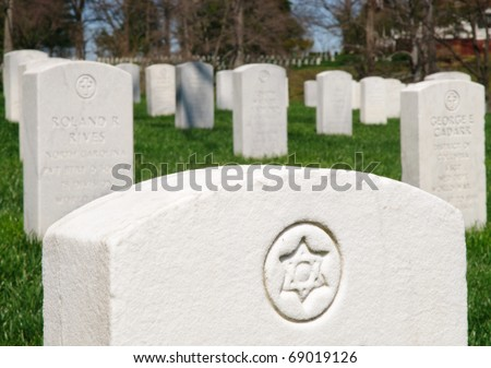 Jewish Star of David on a grave stone at Arlington National Cemetery - stock photo