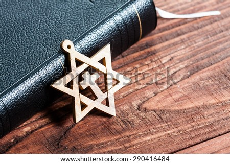 Jewish symbol star of david, on wooden background. - stock photo