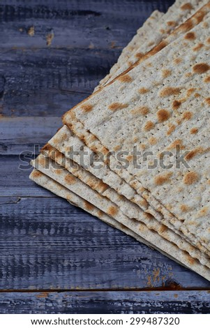 Jewish traditional Passover matzo bread.  Selective focus - stock photo